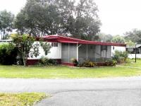 12701 SE Sunset Harbor Rd., Weirsdale, FL 32195